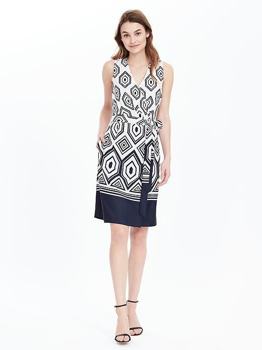 Geo Sleeveless Wrap Dress Preppy Navy - style: faux wrap/wrap; neckline: v-neck; sleeve style: sleeveless; waist detail: belted waist/tie at waist/drawstring; predominant colour: white; secondary colour: navy; occasions: evening; length: on the knee; fit: body skimming; fibres: polyester/polyamide - 100%; sleeve length: sleeveless; texture group: cotton feel fabrics; pattern type: fabric; pattern: patterned/print; multicoloured: multicoloured; season: s/s 2016; wardrobe: event
