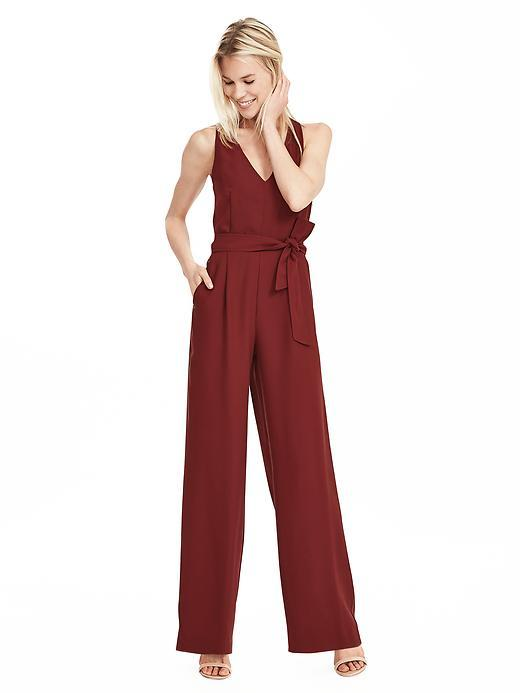 Wide Leg Jumpsuit Rich Red - length: standard; neckline: low v-neck; fit: fitted at waist; pattern: plain; sleeve style: sleeveless; waist detail: belted waist/tie at waist/drawstring; predominant colour: true red; occasions: evening, occasion; fibres: polyester/polyamide - 100%; sleeve length: sleeveless; texture group: crepes; style: jumpsuit; pattern type: fabric; season: s/s 2016; wardrobe: event