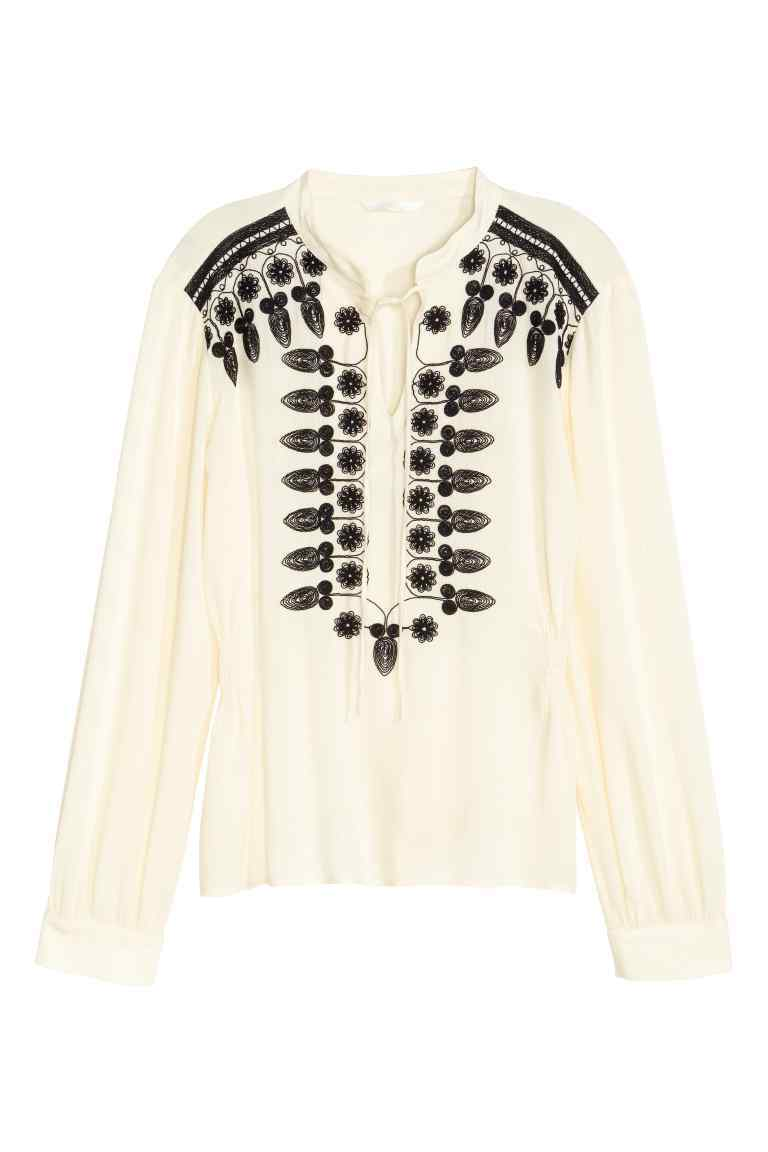 Embroidered Blouse - neckline: round neck; bust detail: added detail/embellishment at bust; style: blouse; predominant colour: ivory/cream; secondary colour: black; occasions: casual, holiday; length: standard; fibres: cotton - 100%; fit: body skimming; sleeve length: long sleeve; sleeve style: standard; trends: monochrome; pattern type: fabric; pattern size: standard; pattern: patterned/print; texture group: other - light to midweight; embellishment: embroidered; season: s/s 2016; wardrobe: highlight