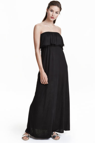 Bandeau Dress - neckline: strapless (straight/sweetheart); fit: empire; pattern: plain; style: maxi dress; sleeve style: strapless; length: ankle length; predominant colour: black; occasions: casual, holiday; fibres: polyester/polyamide - 100%; sleeve length: sleeveless; texture group: sheer fabrics/chiffon/organza etc.; bust detail: tiers/frills/bulky drapes/pleats; pattern type: fabric; season: s/s 2016; wardrobe: highlight