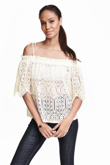 Lace Off The Shoulder Blouse - neckline: off the shoulder; style: blouse; predominant colour: ivory/cream; occasions: casual; length: standard; fibres: polyester/polyamide - 100%; fit: loose; sleeve length: half sleeve; sleeve style: standard; texture group: lace; pattern type: fabric; pattern: patterned/print; embellishment: lace; season: s/s 2016; wardrobe: highlight