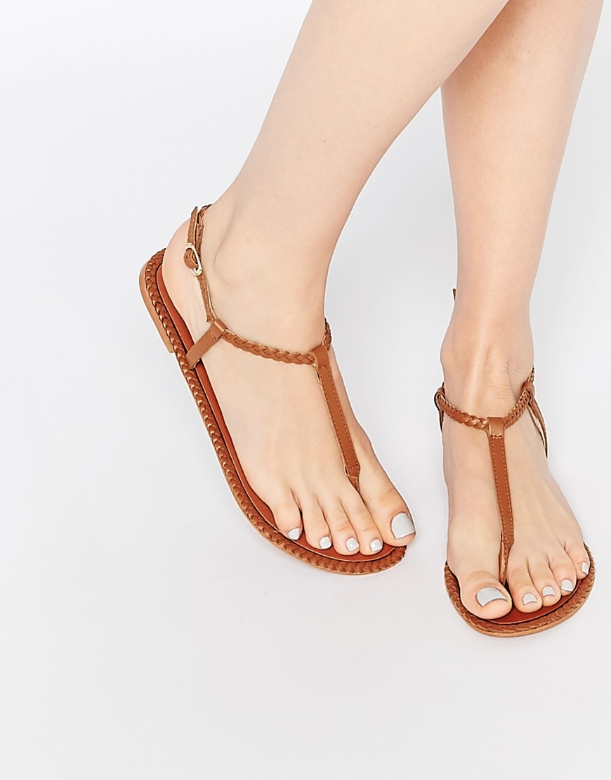 Feather Leather Plait Sandals Tan - predominant colour: tan; occasions: casual, holiday; material: leather; heel height: flat; ankle detail: ankle strap; heel: standard; toe: toe thongs; style: strappy; finish: plain; pattern: plain; season: s/s 2016; wardrobe: highlight