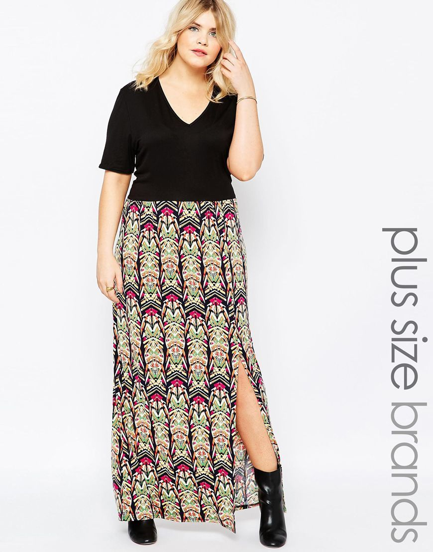 Plus Maxi Dress With V Neck And Geo Printed Skirt Geo Print - neckline: v-neck; style: maxi dress; secondary colour: hot pink; predominant colour: black; occasions: evening; length: floor length; fit: body skimming; fibres: viscose/rayon - stretch; hip detail: slits at hip; sleeve length: half sleeve; sleeve style: standard; pattern type: fabric; pattern: patterned/print; texture group: jersey - stretchy/drapey; multicoloured: multicoloured; season: s/s 2016; wardrobe: event