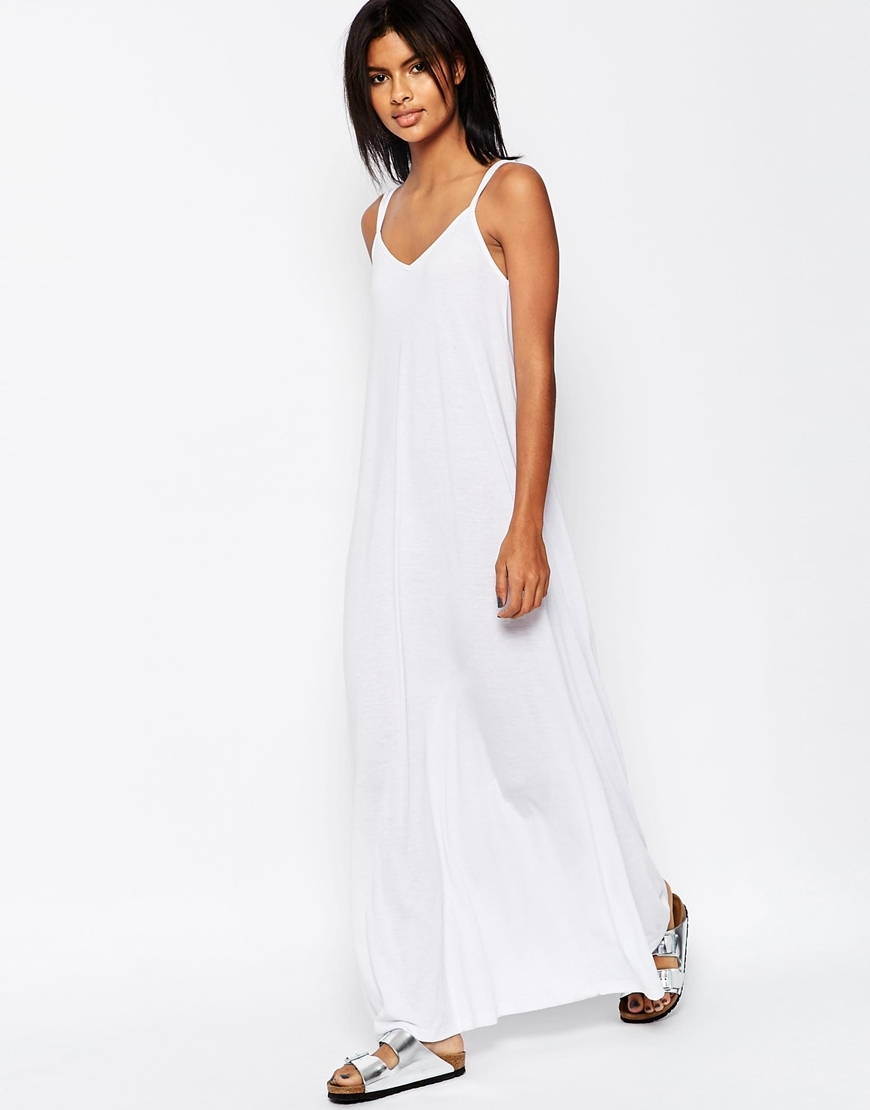 Strappy Maxi Dress White - neckline: v-neck; sleeve style: spaghetti straps; pattern: plain; style: maxi dress; length: ankle length; predominant colour: white; occasions: casual, holiday; fit: body skimming; fibres: polyester/polyamide - mix; sleeve length: sleeveless; pattern type: fabric; texture group: jersey - stretchy/drapey; season: s/s 2016; wardrobe: basic