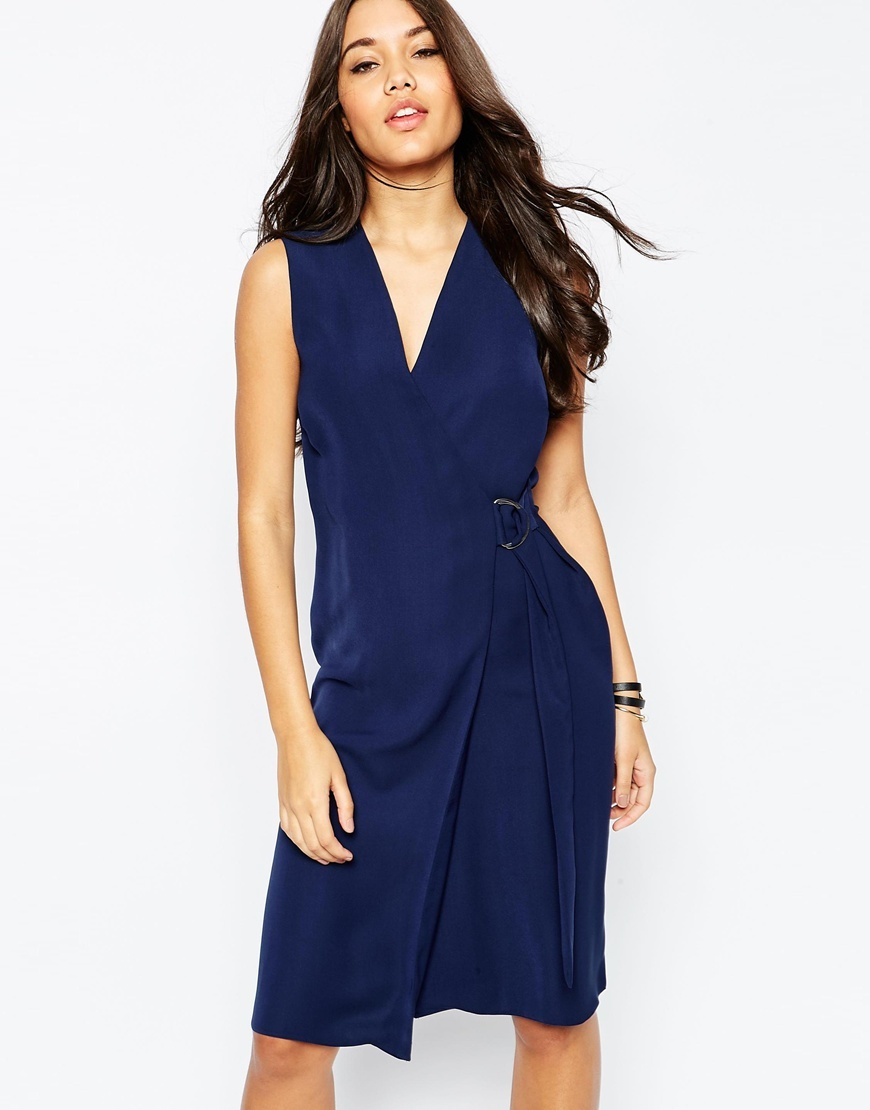 Soft Wrap Pencil Dress With D Ring Navy - style: faux wrap/wrap; neckline: v-neck; pattern: plain; sleeve style: sleeveless; predominant colour: navy; occasions: evening; length: on the knee; fit: body skimming; fibres: polyester/polyamide - mix; sleeve length: sleeveless; pattern type: fabric; texture group: jersey - stretchy/drapey; season: s/s 2016; wardrobe: event