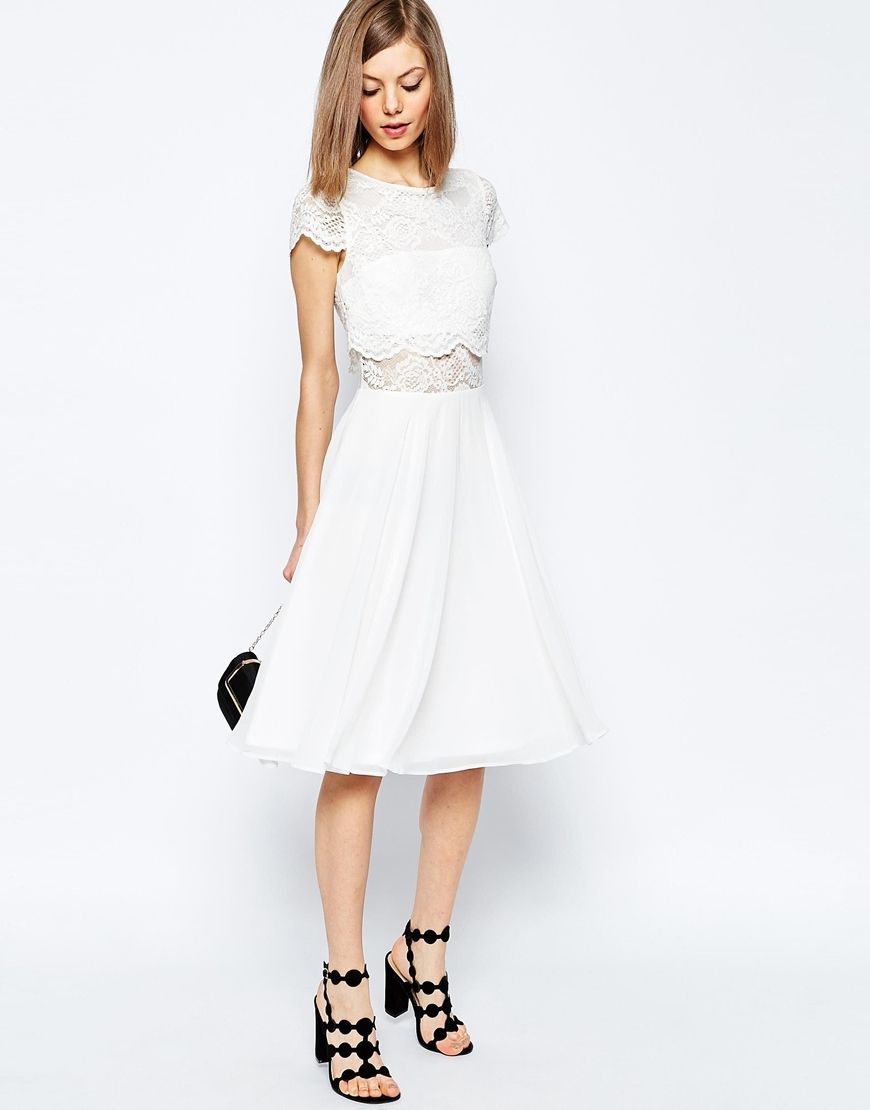 Crop Top Lace Midi Dress Navy - length: below the knee; pattern: plain; predominant colour: ivory/cream; occasions: evening; fit: fitted at waist & bust; style: fit & flare; fibres: nylon - mix; neckline: crew; sleeve length: short sleeve; sleeve style: standard; texture group: sheer fabrics/chiffon/organza etc.; pattern type: fabric; embellishment: lace; season: s/s 2016; wardrobe: event; embellishment location: top
