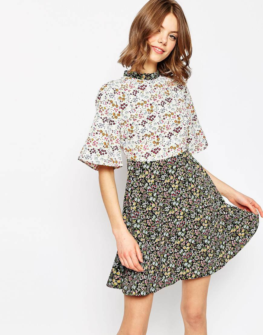 Ditsy Floral Printed Skater Dress Multi - length: mid thigh; neckline: high neck; secondary colour: ivory/cream; predominant colour: black; occasions: evening; fit: fitted at waist & bust; style: fit & flare; fibres: polyester/polyamide - 100%; sleeve length: short sleeve; sleeve style: standard; pattern type: fabric; pattern: florals; texture group: woven light midweight; multicoloured: multicoloured; season: s/s 2016; wardrobe: event