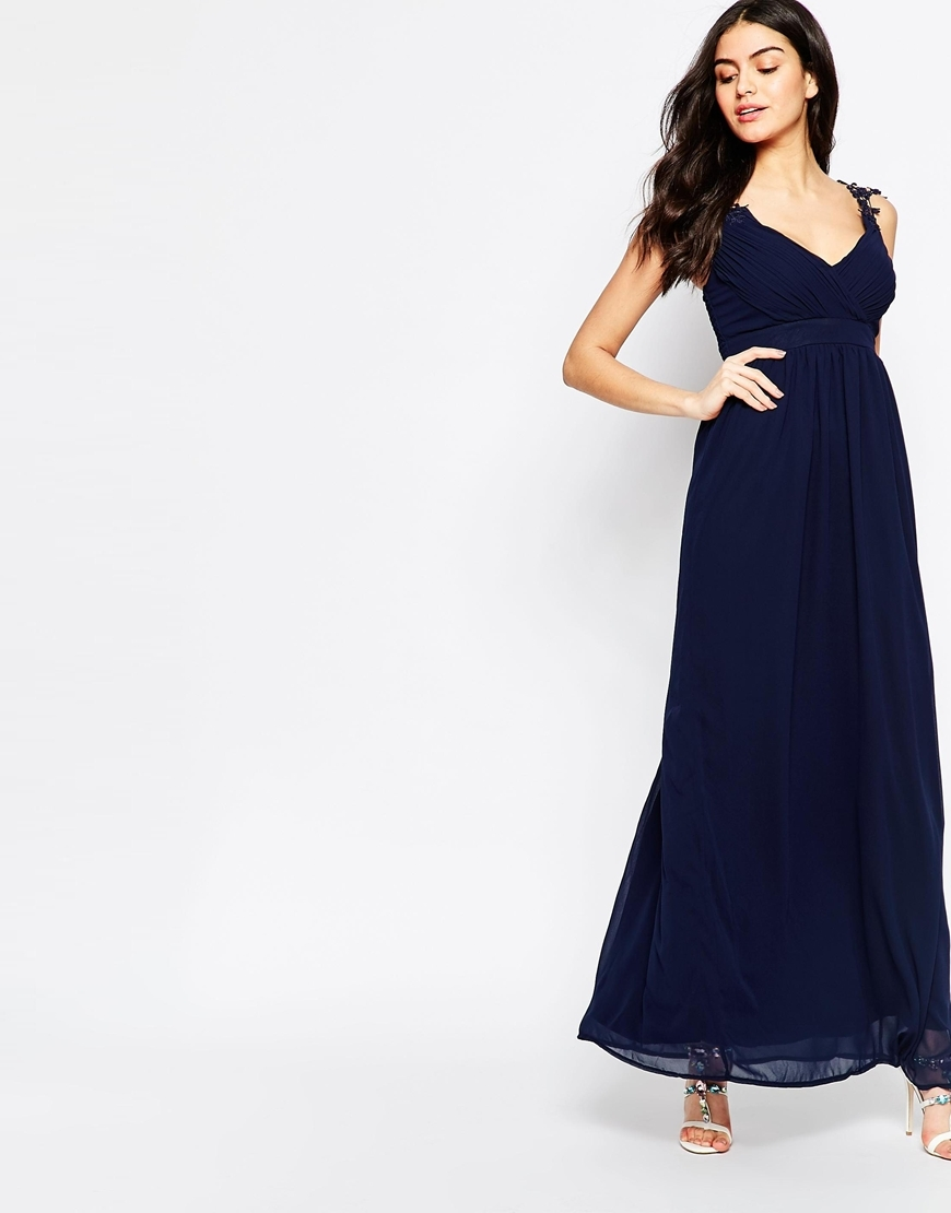 Wrap Front Occasion Maxi Dress With Crochet Straps Navy - neckline: low v-neck; pattern: plain; sleeve style: sleeveless; style: maxi dress; predominant colour: navy; occasions: evening; length: floor length; fit: body skimming; fibres: polyester/polyamide - 100%; sleeve length: sleeveless; pattern type: fabric; texture group: jersey - stretchy/drapey; season: s/s 2016; wardrobe: event
