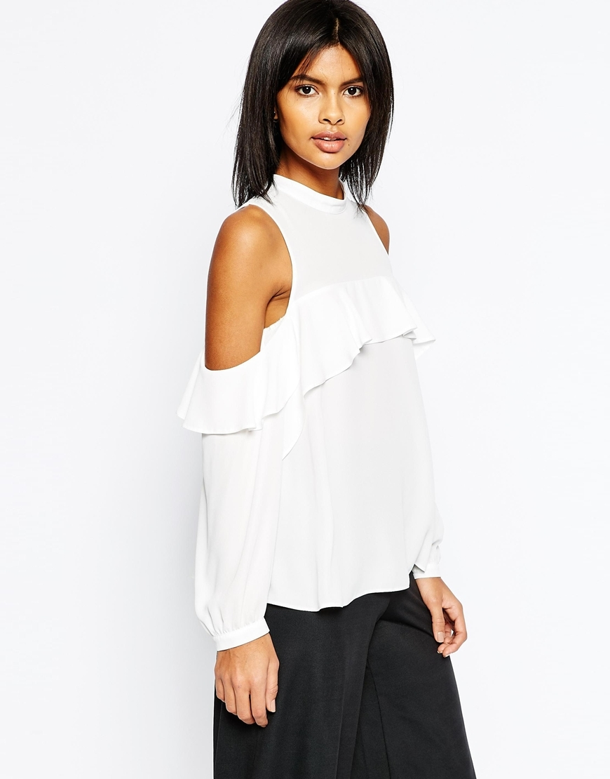 Cold Shoulder Top With Ruffle Detail Ivory - pattern: plain; neckline: high neck; style: blouse; predominant colour: ivory/cream; occasions: casual; length: standard; fibres: polyester/polyamide - 100%; fit: body skimming; shoulder detail: cut out shoulder; sleeve length: long sleeve; sleeve style: standard; texture group: sheer fabrics/chiffon/organza etc.; bust detail: bulky details at bust; pattern type: fabric; season: s/s 2016; wardrobe: highlight