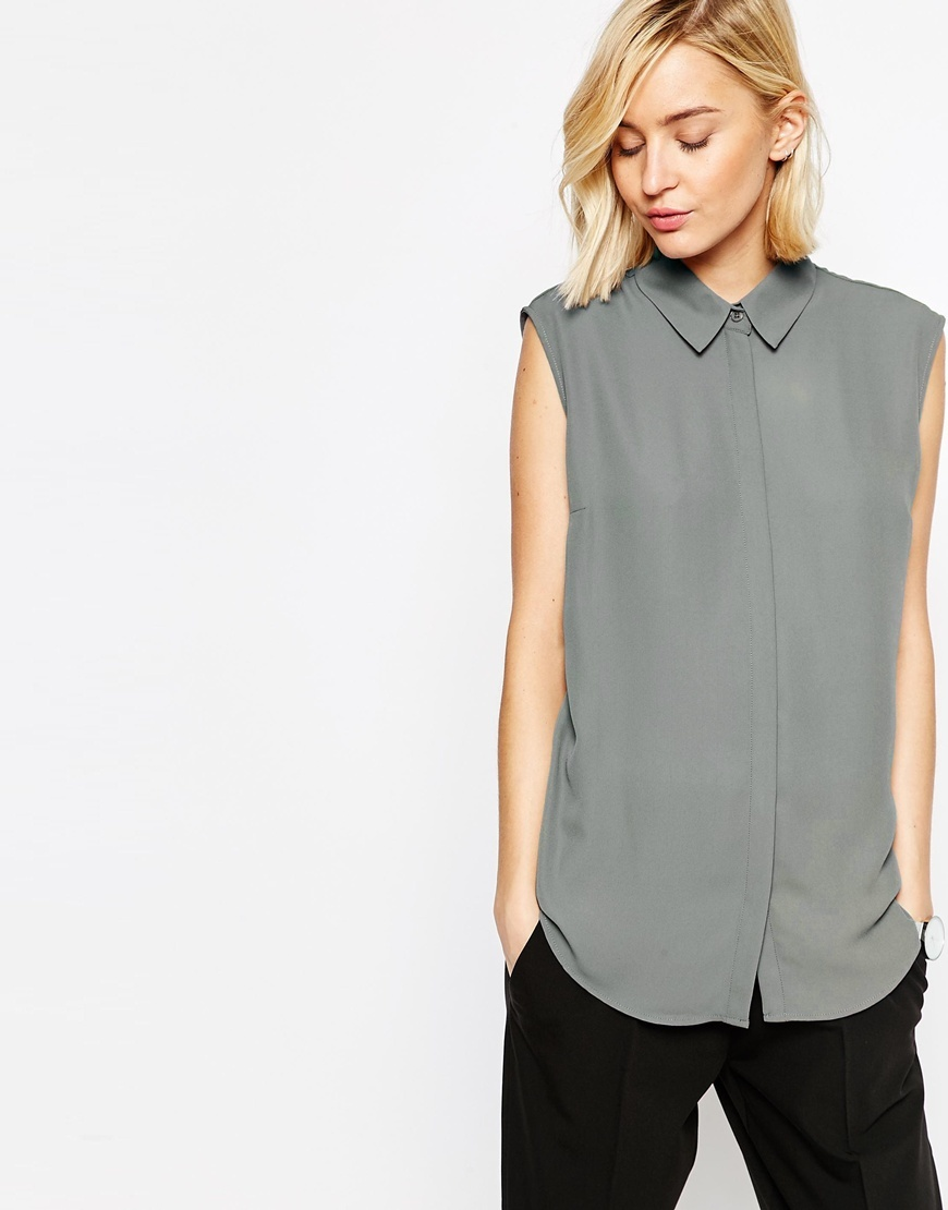 Sleeveless Blouse Charcoal - neckline: shirt collar/peter pan/zip with opening; pattern: plain; sleeve style: sleeveless; back detail: racer back/sports back; style: blouse; predominant colour: mid grey; occasions: casual; length: standard; fibres: polyester/polyamide - 100%; fit: body skimming; sleeve length: sleeveless; texture group: sheer fabrics/chiffon/organza etc.; pattern type: fabric; season: s/s 2016; wardrobe: basic