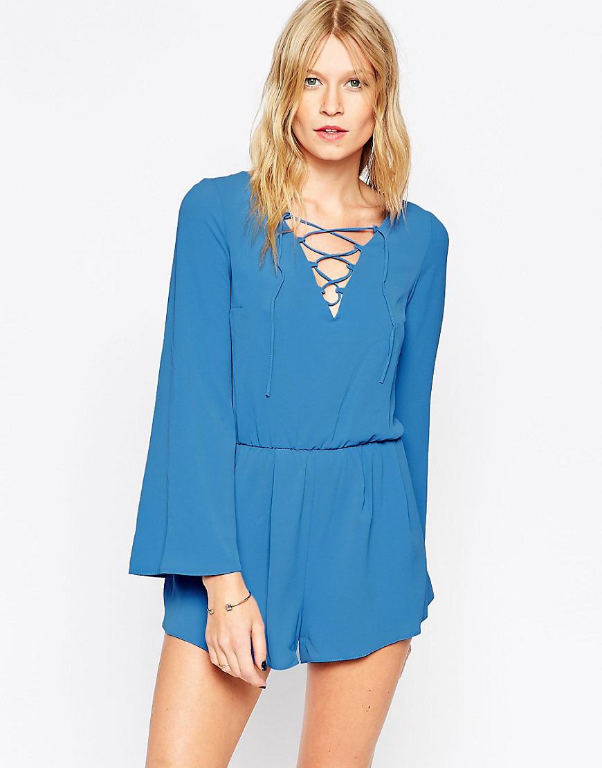 Lace Front Playsuit Blue - neckline: v-neck; pattern: plain; length: short shorts; predominant colour: turquoise; occasions: casual; fit: body skimming; fibres: polyester/polyamide - 100%; sleeve length: long sleeve; sleeve style: standard; style: playsuit; pattern type: fabric; texture group: other - light to midweight; season: s/s 2016; wardrobe: highlight