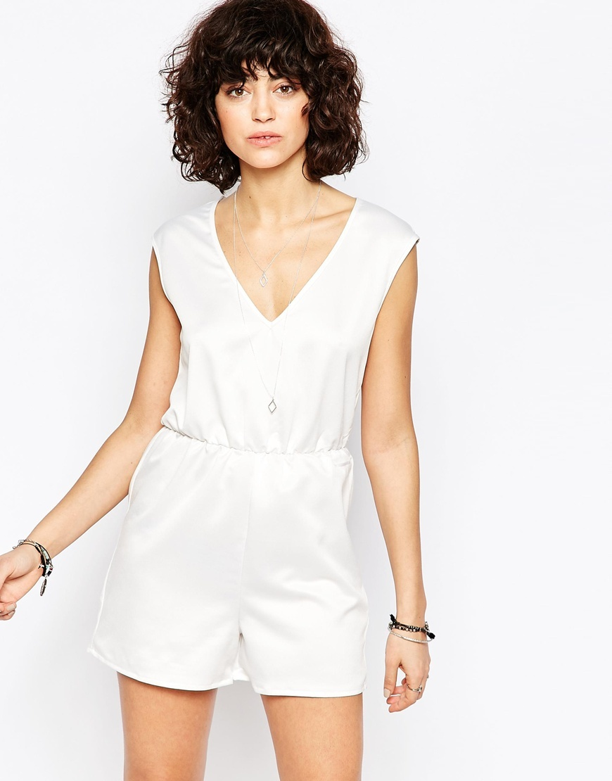 Playsuit With Plunge Neck White - neckline: v-neck; pattern: plain; sleeve style: sleeveless; length: short shorts; predominant colour: white; occasions: casual; fit: body skimming; fibres: polyester/polyamide - stretch; hip detail: adds bulk at the hips; sleeve length: sleeveless; style: playsuit; pattern type: fabric; texture group: jersey - stretchy/drapey; season: s/s 2016; wardrobe: highlight