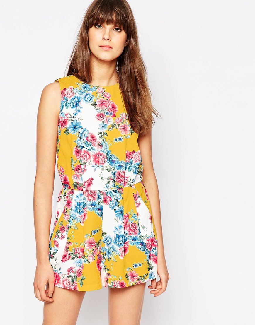Sass And Sunshine Playsuit In Floral Print Yellow - sleeve style: sleeveless; length: short shorts; secondary colour: white; predominant colour: mustard; occasions: casual; fit: body skimming; fibres: cotton - mix; neckline: crew; hip detail: adds bulk at the hips; sleeve length: sleeveless; style: playsuit; pattern type: fabric; pattern: florals; texture group: jersey - stretchy/drapey; multicoloured: multicoloured; season: s/s 2016; wardrobe: highlight