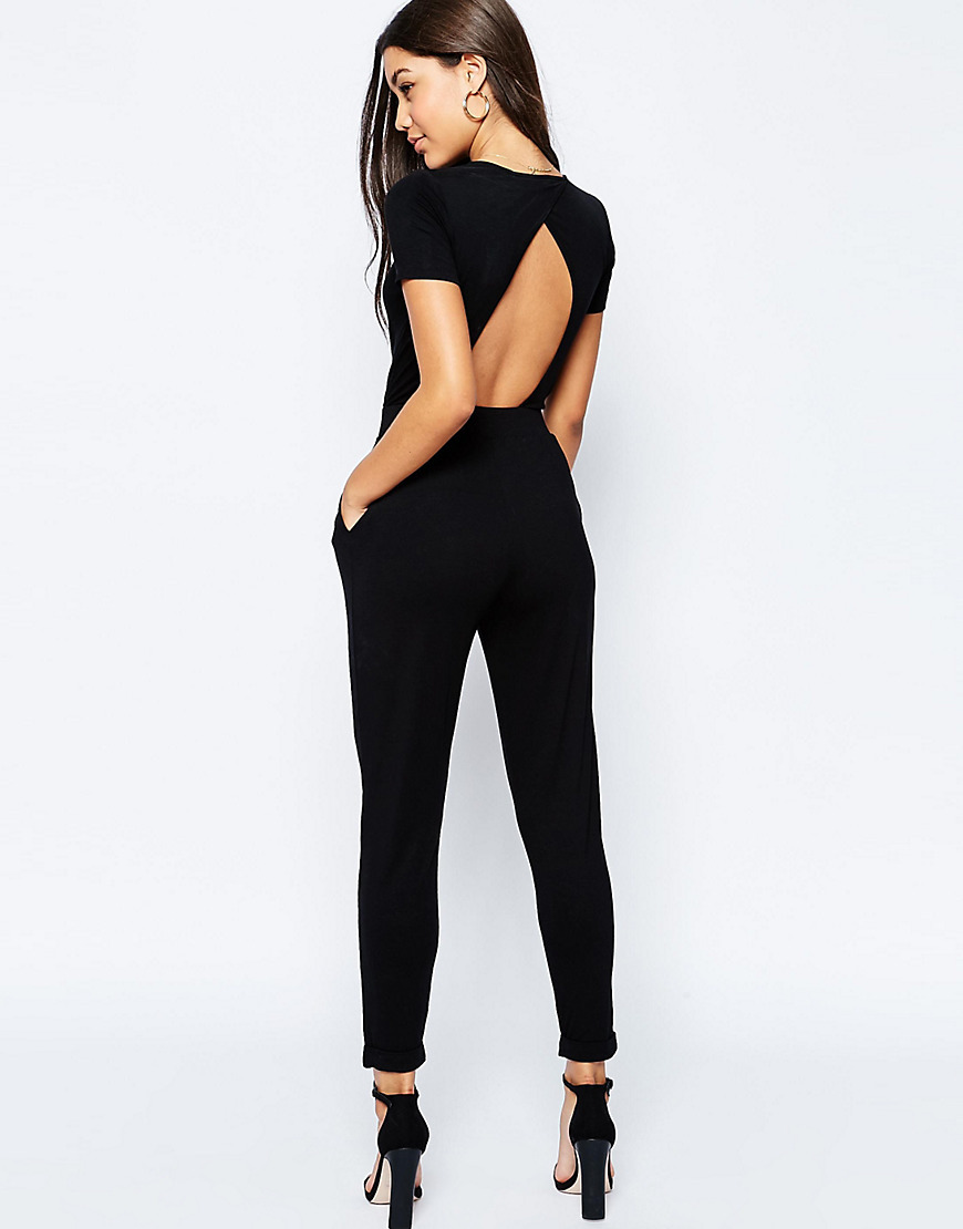 Wrap Front Jersey Jumpsuit With Short Sleeve Black - length: standard; neckline: v-neck; pattern: plain; back detail: back revealing; predominant colour: black; occasions: casual; fit: body skimming; fibres: viscose/rayon - stretch; sleeve length: short sleeve; sleeve style: standard; style: jumpsuit; pattern type: fabric; texture group: jersey - stretchy/drapey; season: s/s 2016; wardrobe: highlight