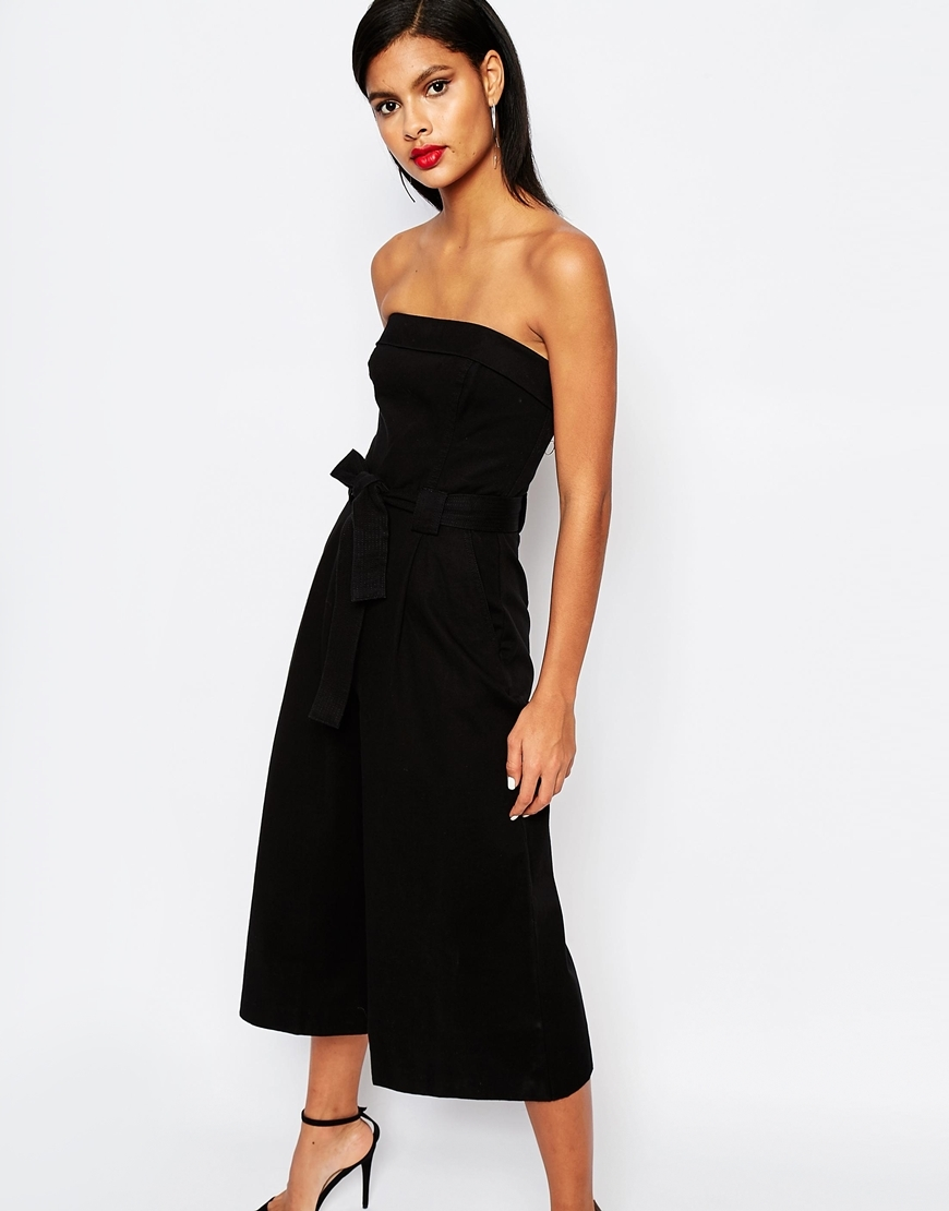 Kenyan Twill Strapless Jumpsuit Black - neckline: strapless (straight/sweetheart); pattern: plain; sleeve style: strapless; waist detail: belted waist/tie at waist/drawstring; predominant colour: black; occasions: evening, occasion; length: calf length; fit: fitted at waist & bust; fibres: polyester/polyamide - 100%; sleeve length: sleeveless; texture group: crepes; style: jumpsuit; pattern type: fabric; season: s/s 2016
