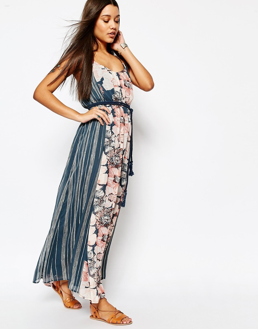 Chiffon Maxi Dress With Rope Belt Floral Print - neckline: low v-neck; sleeve style: sleeveless; style: maxi dress; length: ankle length; waist detail: belted waist/tie at waist/drawstring; secondary colour: blush; predominant colour: denim; fit: body skimming; fibres: polyester/polyamide - 100%; occasions: occasion; sleeve length: sleeveless; pattern type: fabric; pattern size: big & busy; pattern: florals; texture group: other - light to midweight; season: s/s 2016; wardrobe: event