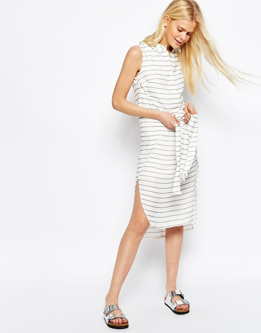 Tie Front Sleeveless Shirt Dress In Stripe Ivory - style: shirt; length: below the knee; neckline: shirt collar/peter pan/zip with opening; pattern: horizontal stripes; sleeve style: sleeveless; waist detail: belted waist/tie at waist/drawstring; predominant colour: white; secondary colour: black; occasions: casual; fit: straight cut; hip detail: slits at hip; sleeve length: sleeveless; pattern type: fabric; pattern size: standard; texture group: woven light midweight; fibres: viscose/rayon - mix; season: s/s 2016