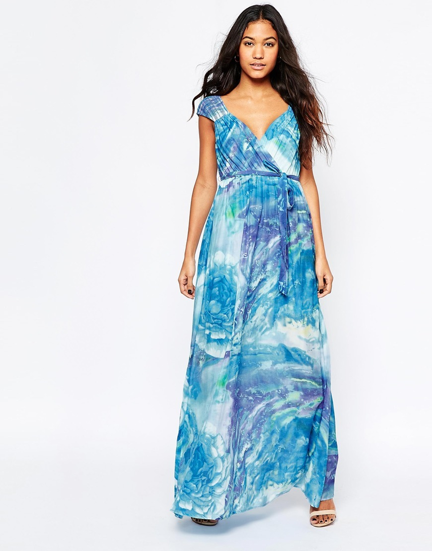 Silk Blessings Maxi Dress In Watercolour Print Blue - neckline: low v-neck; sleeve style: capped; fit: fitted at waist; style: maxi dress; length: ankle length; predominant colour: diva blue; fibres: cotton - mix; occasions: occasion, holiday; hip detail: soft pleats at hip/draping at hip/flared at hip; sleeve length: short sleeve; texture group: silky - light; pattern type: fabric; pattern size: big & busy; pattern: patterned/print; multicoloured: multicoloured; season: s/s 2016