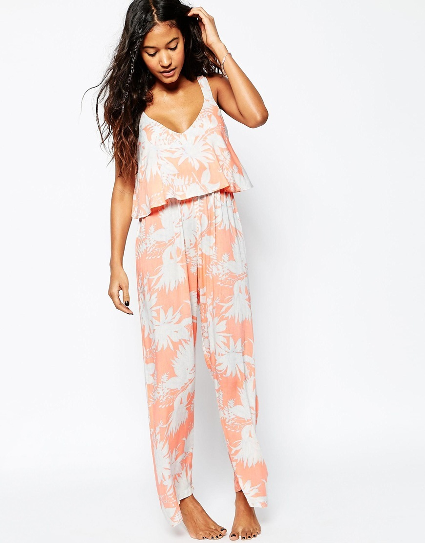 Peach Floral Print Frill Beach Jumpsuit Peach Floral - length: standard; neckline: v-neck; sleeve style: sleeveless; secondary colour: white; predominant colour: coral; occasions: casual; fit: body skimming; fibres: viscose/rayon - 100%; sleeve length: sleeveless; style: jumpsuit; pattern type: fabric; pattern: florals; texture group: jersey - stretchy/drapey; multicoloured: multicoloured; season: s/s 2016; wardrobe: highlight