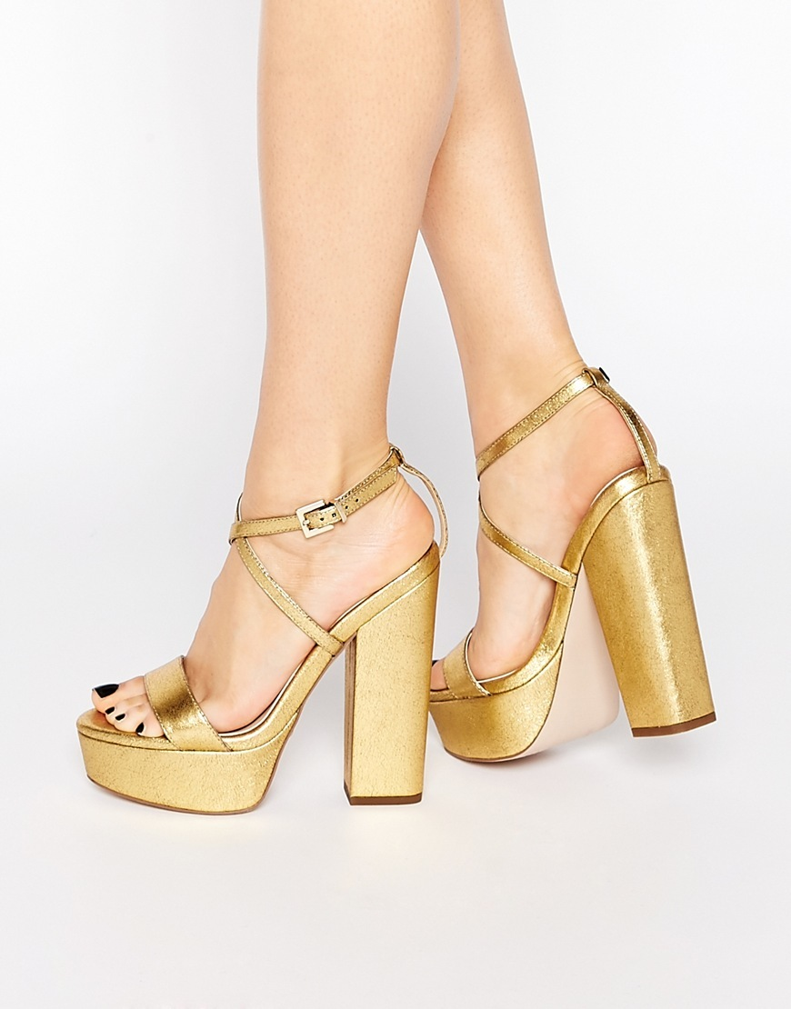Highway Platform Sandals Gold - predominant colour: gold; occasions: evening, occasion; material: faux leather; ankle detail: ankle strap; heel: block; toe: open toe/peeptoe; style: strappy; finish: metallic; pattern: plain; heel height: very high; shoe detail: platform; season: s/s 2016; wardrobe: event