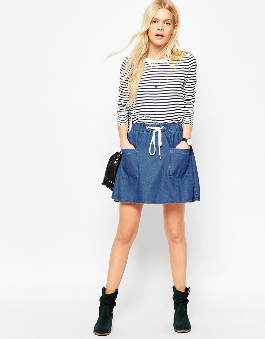 Denim High Waist With Rope Tie Mini Skirt In Mid Wash Blue Midwash Blue - pattern: plain; style: full/prom skirt; fit: loose/voluminous; waist: high rise; waist detail: belted waist/tie at waist/drawstring; predominant colour: denim; occasions: casual, creative work; length: just above the knee; fibres: cotton - 100%; texture group: denim; pattern type: fabric; season: s/s 2016; wardrobe: basic