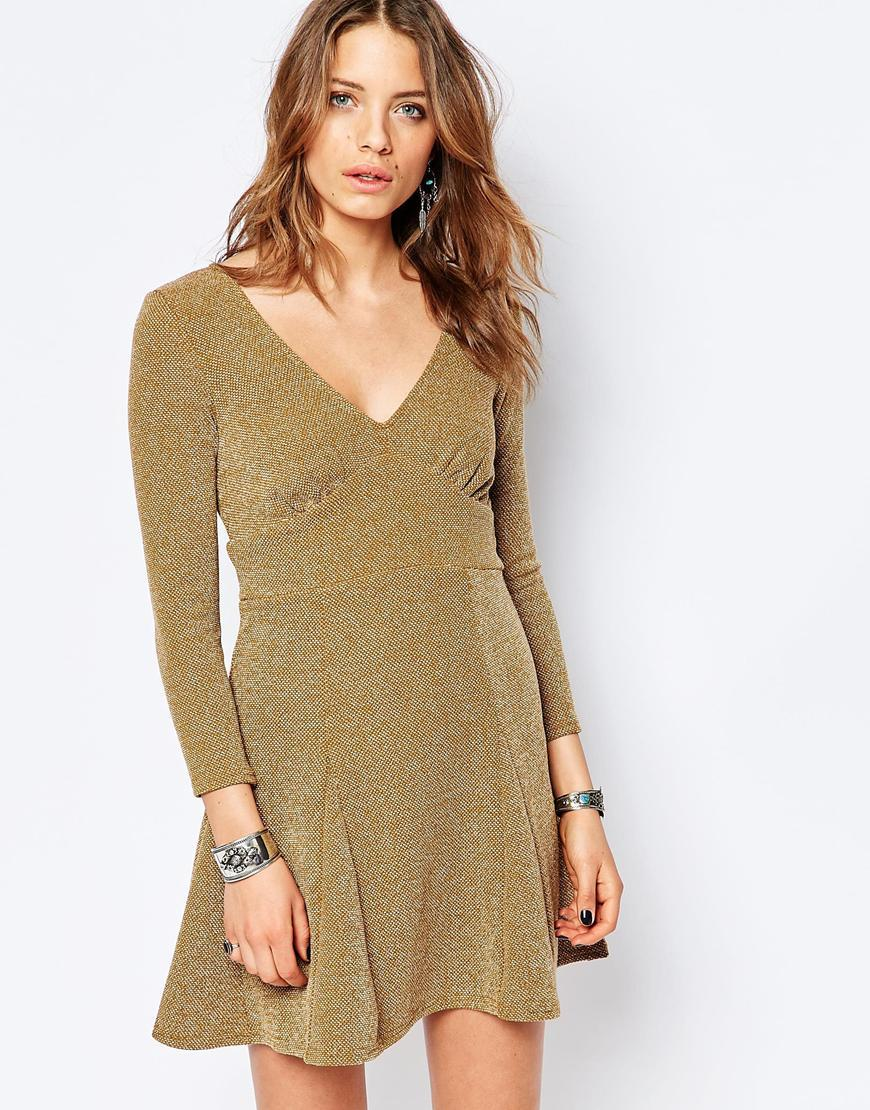 Heartstopper Mini Dress Brown - neckline: low v-neck; pattern: plain; predominant colour: khaki; occasions: casual, creative work; length: just above the knee; fit: fitted at waist & bust; style: fit & flare; fibres: polyester/polyamide - mix; sleeve length: 3/4 length; sleeve style: standard; pattern type: fabric; texture group: jersey - stretchy/drapey; season: s/s 2016; wardrobe: basic