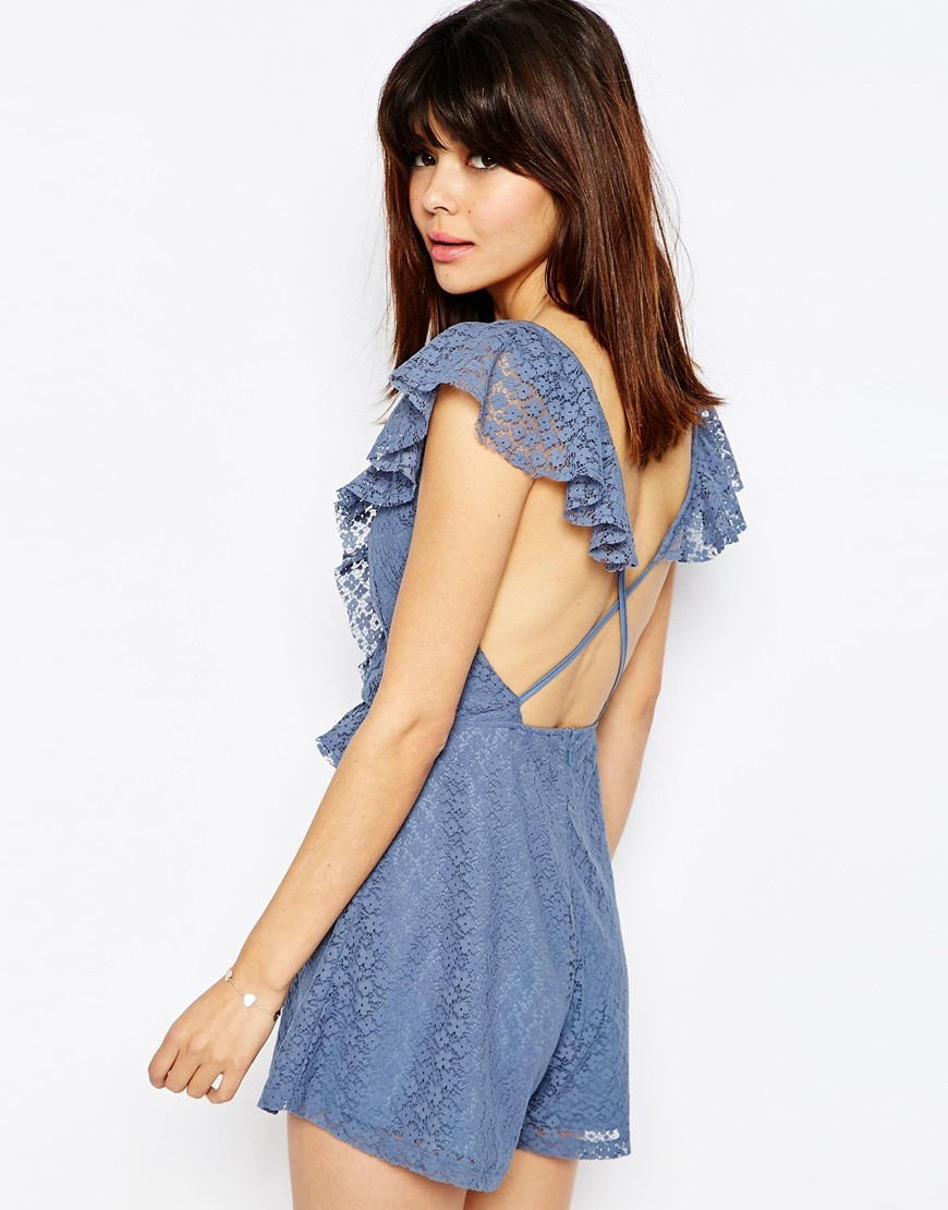 Ruffle Back Lace Playsuit Blue - neckline: low v-neck; sleeve style: capped; length: short shorts; predominant colour: denim; occasions: casual; fit: body skimming; fibres: polyester/polyamide - 100%; back detail: crossover; sleeve length: short sleeve; texture group: sheer fabrics/chiffon/organza etc.; style: playsuit; pattern type: fabric; pattern: florals; season: s/s 2016