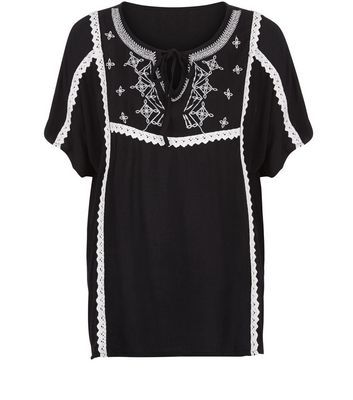 Black Embroidered Blouse - pattern: plain; style: blouse; secondary colour: white; predominant colour: black; occasions: casual; length: standard; neckline: collarstand & mandarin with v-neck; fibres: viscose/rayon - 100%; fit: body skimming; sleeve length: short sleeve; sleeve style: standard; trends: monochrome; pattern type: fabric; texture group: jersey - stretchy/drapey; embellishment: embroidered; season: s/s 2016