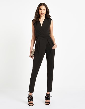 Wrap Jumpsuit - length: standard; neckline: v-neck; pattern: plain; sleeve style: sleeveless; predominant colour: black; occasions: evening; fit: body skimming; fibres: polyester/polyamide - stretch; sleeve length: sleeveless; style: jumpsuit; pattern type: fabric; texture group: jersey - stretchy/drapey; season: s/s 2016; wardrobe: event
