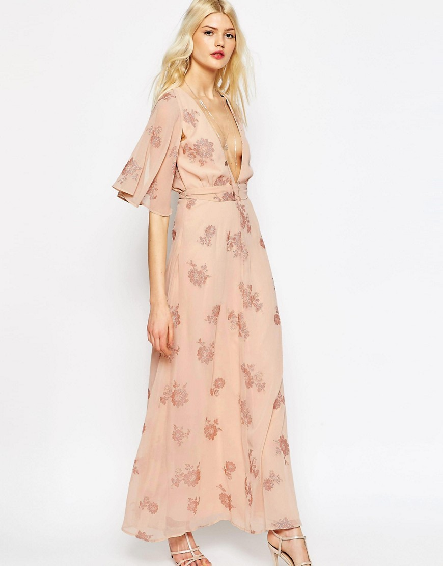 Flutter Sleeve Maxi Dress With Pretty Florals Nude - neckline: plunge; style: maxi dress; length: ankle length; waist detail: belted waist/tie at waist/drawstring; predominant colour: nude; occasions: evening; fit: body skimming; fibres: polyester/polyamide - 100%; sleeve length: half sleeve; sleeve style: standard; texture group: sheer fabrics/chiffon/organza etc.; pattern type: fabric; pattern: florals; season: s/s 2016; wardrobe: event