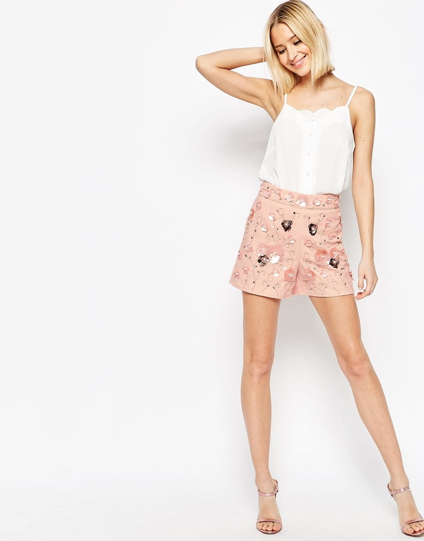 Occasion Floral Embellished Shorts Mu1 - waist: high rise; predominant colour: coral; secondary colour: gold; occasions: evening; fibres: polyester/polyamide - 100%; waist detail: feature waist detail; texture group: crepes; pattern type: fabric; pattern: patterned/print; embellishment: sequins; pattern size: standard (bottom); season: s/s 2016; style: shorts; length: short shorts; fit: slim leg; wardrobe: event; embellishment location: all over