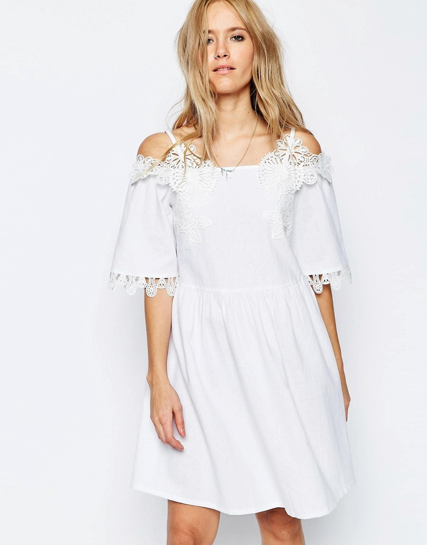 Embroidered Off Shoulder Sundress White - neckline: off the shoulder; pattern: plain; style: sundress; predominant colour: white; occasions: casual, holiday; length: just above the knee; fit: soft a-line; fibres: polyester/polyamide - 100%; sleeve length: short sleeve; sleeve style: standard; pattern type: fabric; texture group: jersey - stretchy/drapey; embellishment: lace; season: s/s 2016; wardrobe: highlight; embellishment location: shoulder, sleeve/cuff