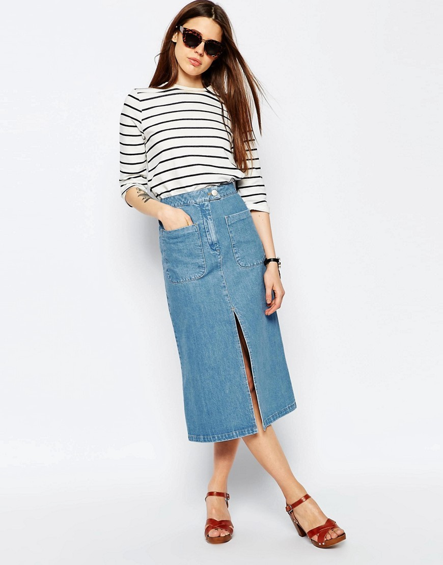 Denim Midi Skirt With Patch Pockets In Mid Wash Blue Mid Wash Blue - length: calf length; pattern: plain; fit: loose/voluminous; waist: high rise; predominant colour: navy; occasions: casual; style: a-line; fibres: cotton - stretch; hip detail: slits at hip; texture group: denim; pattern type: fabric; season: s/s 2016; wardrobe: basic
