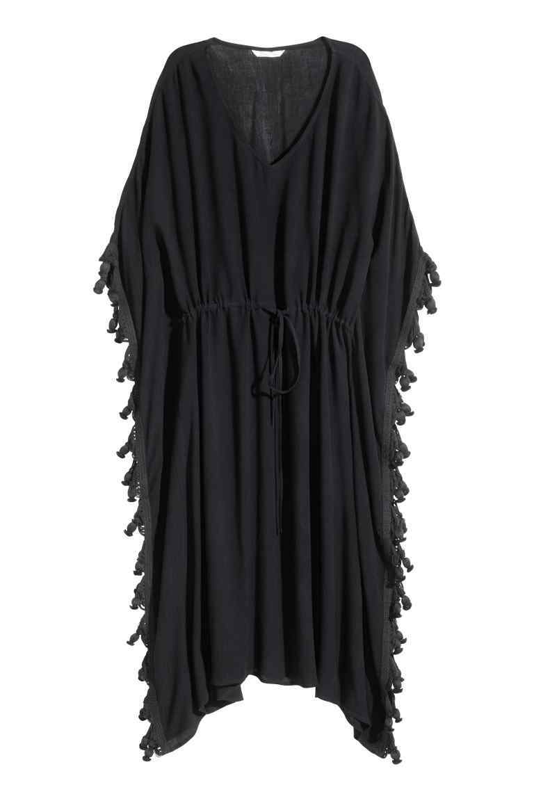 Kaftan Dress - neckline: v-neck; sleeve style: dolman/batwing; fit: loose; pattern: plain; style: kaftan; length: ankle length; predominant colour: black; fibres: viscose/rayon - 100%; sleeve length: short sleeve; occasions: holiday; pattern type: fabric; texture group: jersey - stretchy/drapey; embellishment: fringing; season: s/s 2016; wardrobe: holiday