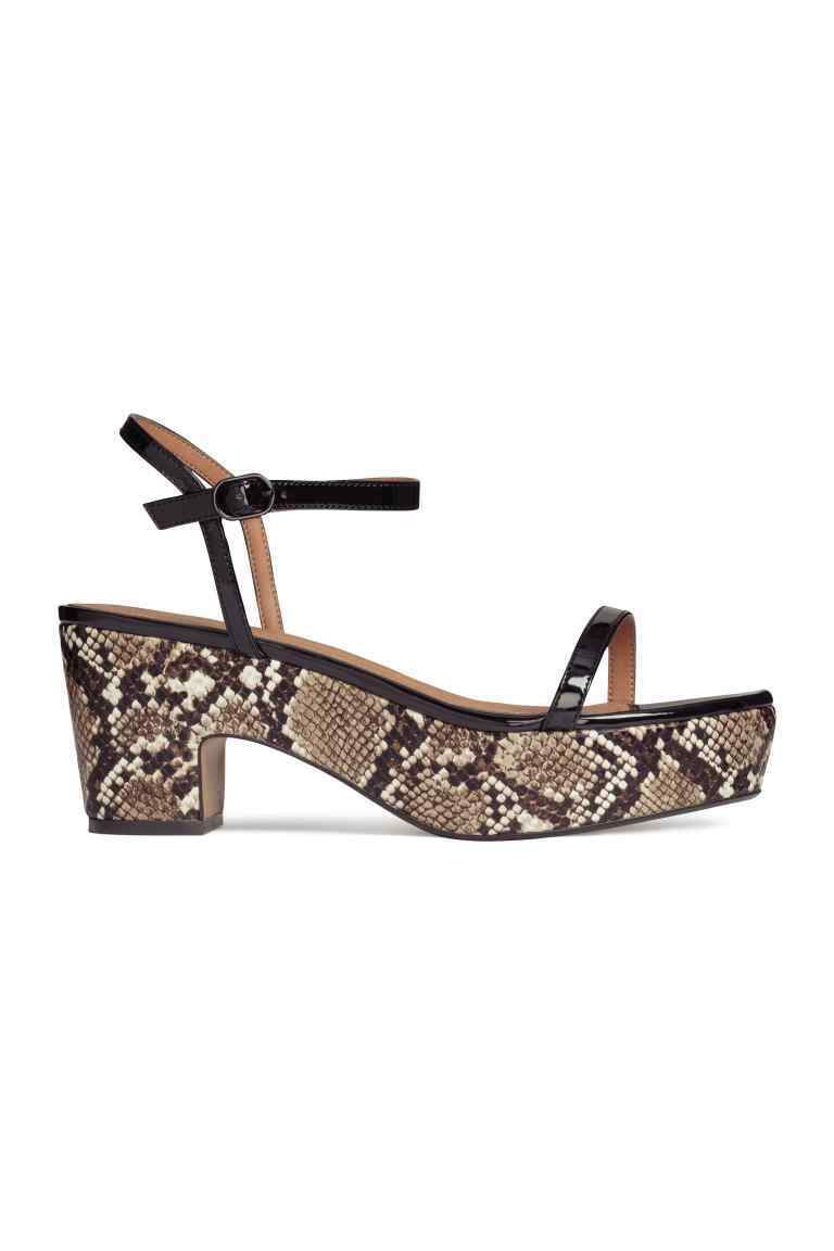 Platform Sandals - secondary colour: stone; predominant colour: black; occasions: casual, creative work; material: faux leather; heel height: high; ankle detail: ankle strap; heel: block; toe: open toe/peeptoe; style: strappy; finish: plain; pattern: animal print; shoe detail: platform; season: s/s 2016; wardrobe: highlight