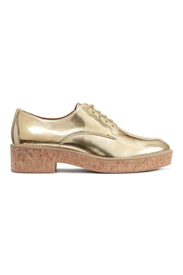 Platform Shoes - predominant colour: gold; occasions: casual, creative work; material: faux leather; heel height: flat; toe: round toe; style: brogues; finish: metallic; pattern: plain; shoe detail: platform; season: s/s 2016