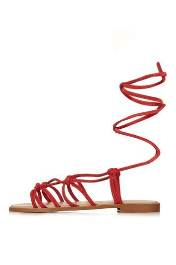 Funfair Knotted Sandals - predominant colour: true red; material: faux leather; heel height: flat; ankle detail: ankle tie; heel: standard; toe: open toe/peeptoe; style: strappy; occasions: holiday; finish: plain; pattern: plain; trends: rebel girl; season: s/s 2016