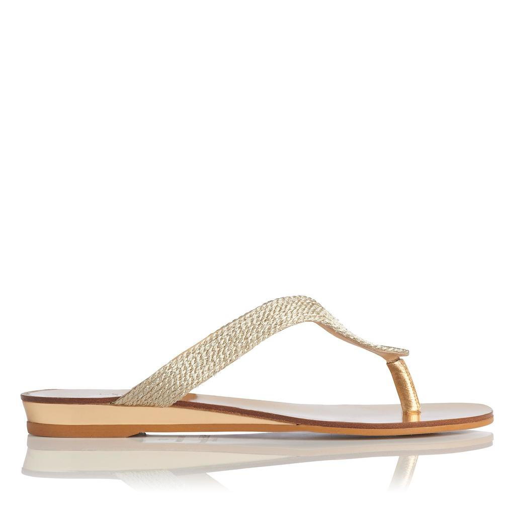 Honey Gold Flat Sandals Metallic Pale Gold - predominant colour: gold; occasions: casual, holiday; material: faux leather; heel height: flat; heel: wedge; toe: toe thongs; style: flip flops; finish: metallic; pattern: plain; season: s/s 2016; wardrobe: highlight