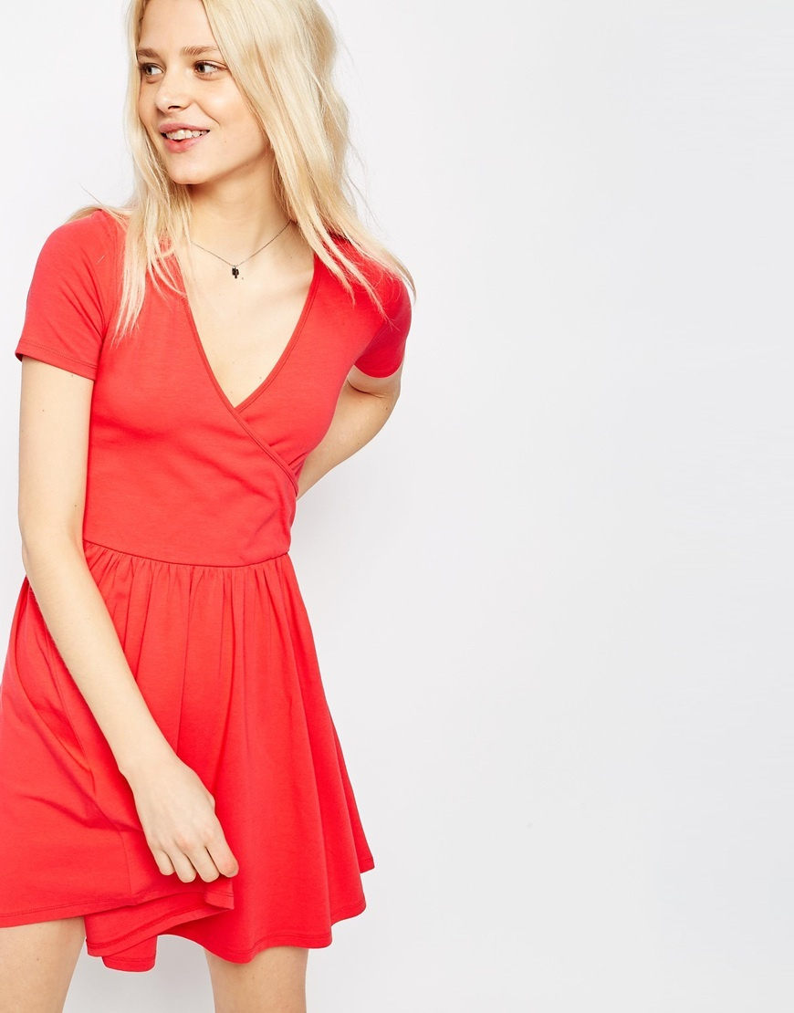Ballet Wrap Skater Mini Dress Coral - style: faux wrap/wrap; length: mid thigh; neckline: v-neck; pattern: plain; predominant colour: coral; occasions: evening; fit: body skimming; fibres: viscose/rayon - stretch; sleeve length: short sleeve; sleeve style: standard; pattern type: fabric; texture group: jersey - stretchy/drapey; season: s/s 2016; wardrobe: event