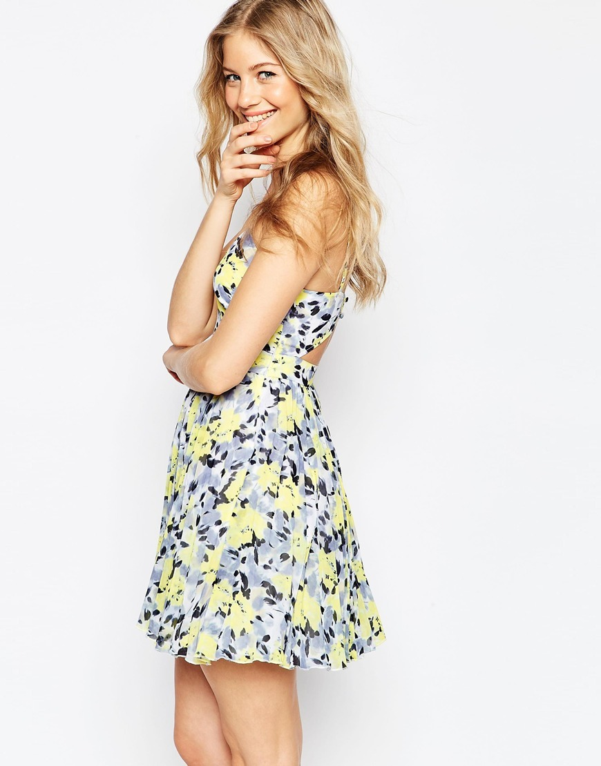 Sheer And Solid Pleated Mini Dress In Bright Lime Floral Multi - length: mini; neckline: low v-neck; sleeve style: spaghetti straps; style: sundress; secondary colour: primrose yellow; predominant colour: light grey; occasions: casual; fit: fitted at waist & bust; fibres: polyester/polyamide - 100%; sleeve length: sleeveless; pattern type: fabric; pattern: florals; texture group: other - light to midweight; multicoloured: multicoloured; season: s/s 2016