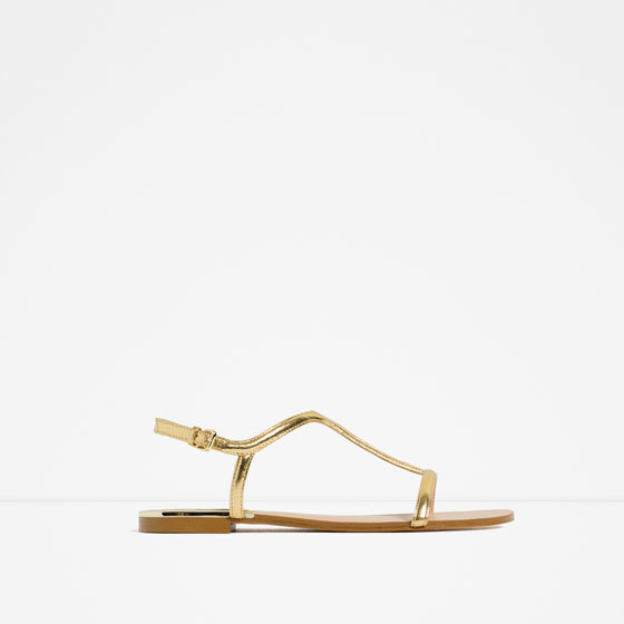Flat Sandals - predominant colour: gold; material: faux leather; heel height: flat; heel: standard; toe: open toe/peeptoe; style: strappy; occasions: holiday; finish: metallic; pattern: plain; season: s/s 2016; wardrobe: basic