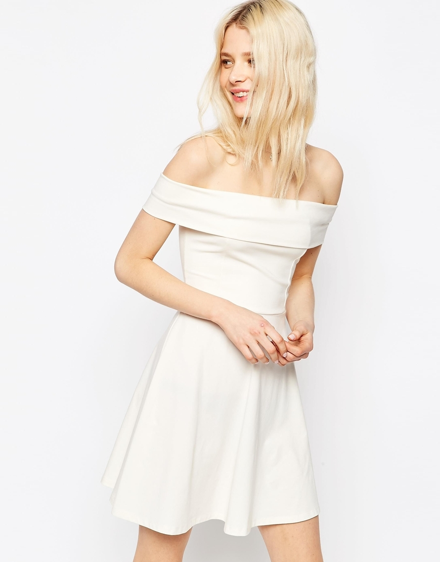 Deep Bardot Off The Shoulder Mini Skater Dress Cream - length: mid thigh; neckline: off the shoulder; pattern: plain; predominant colour: white; occasions: evening; fit: fitted at waist & bust; style: fit & flare; fibres: polyester/polyamide - stretch; hip detail: soft pleats at hip/draping at hip/flared at hip; sleeve length: short sleeve; sleeve style: standard; pattern type: fabric; texture group: jersey - stretchy/drapey; season: s/s 2016; wardrobe: event