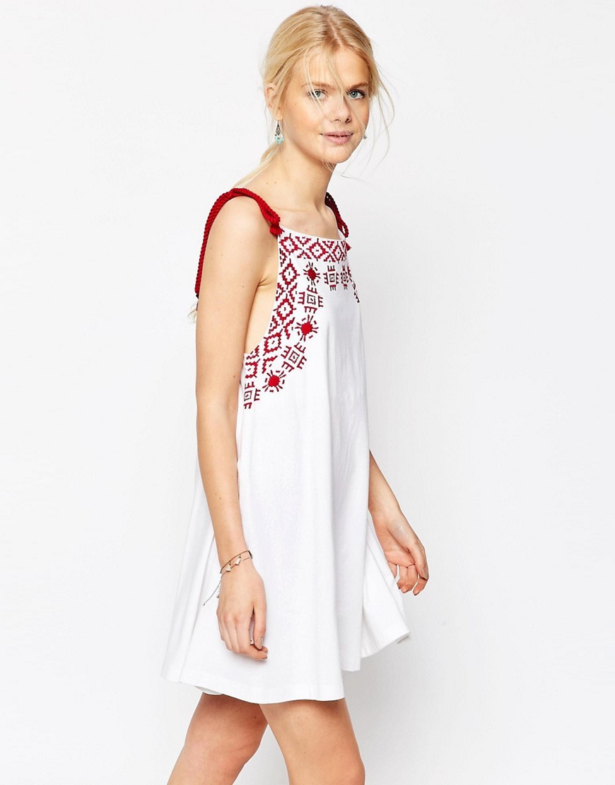 Embroidered Swing Sundress With Rope Straps White - style: shift; length: mid thigh; fit: loose; sleeve style: sleeveless; predominant colour: white; occasions: casual; fibres: cotton - 100%; sleeve length: sleeveless; neckline: medium square neck; pattern type: fabric; pattern size: standard; pattern: patterned/print; texture group: other - light to midweight; embellishment: embroidered; secondary colour: raspberry; season: s/s 2016; wardrobe: highlight