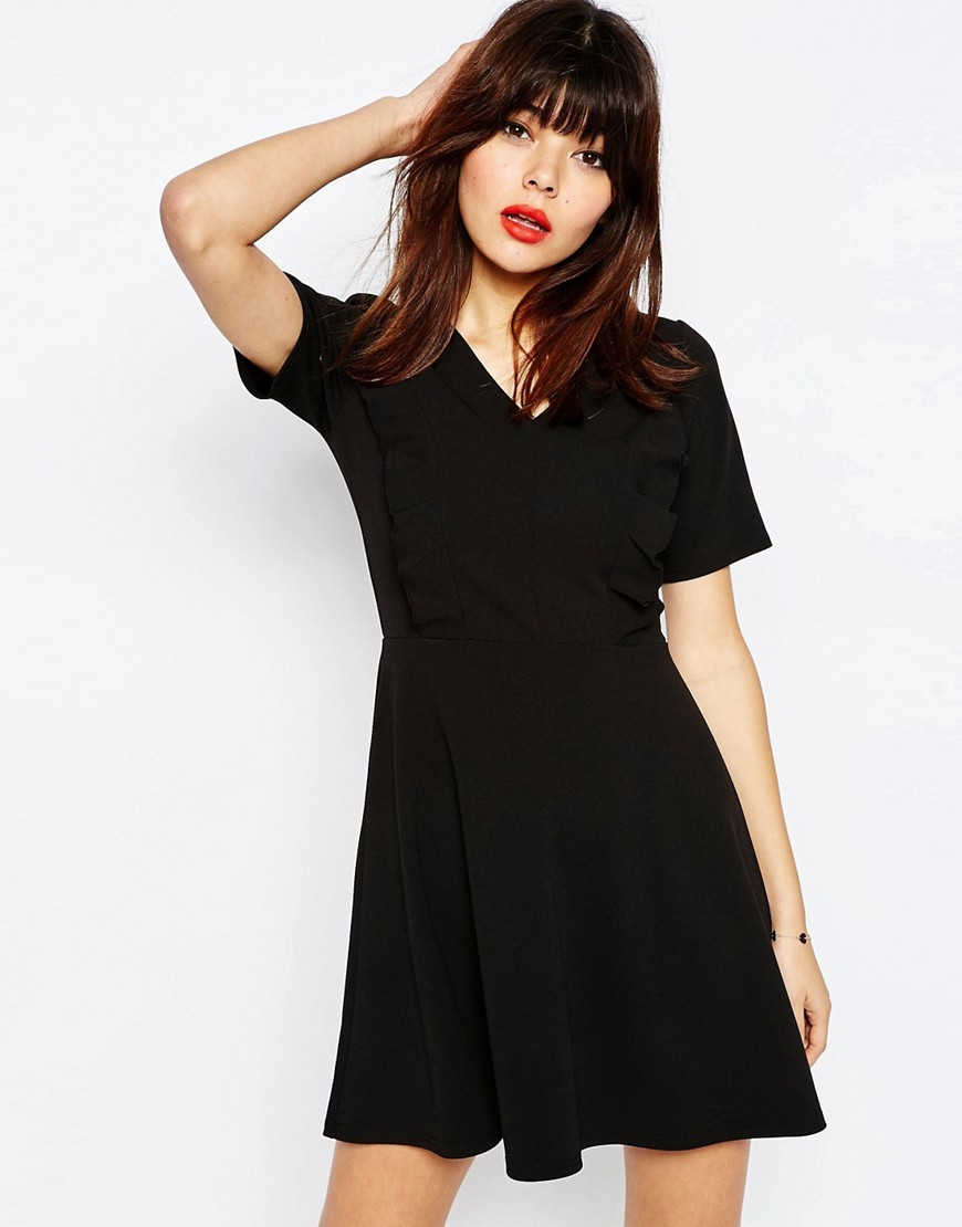 Skater Dress With Ruffle Detail Black - length: mid thigh; neckline: v-neck; pattern: plain; predominant colour: black; occasions: casual; fit: fitted at waist & bust; style: fit & flare; fibres: polyester/polyamide - stretch; sleeve length: short sleeve; sleeve style: standard; pattern type: fabric; texture group: jersey - stretchy/drapey; season: s/s 2016; wardrobe: basic