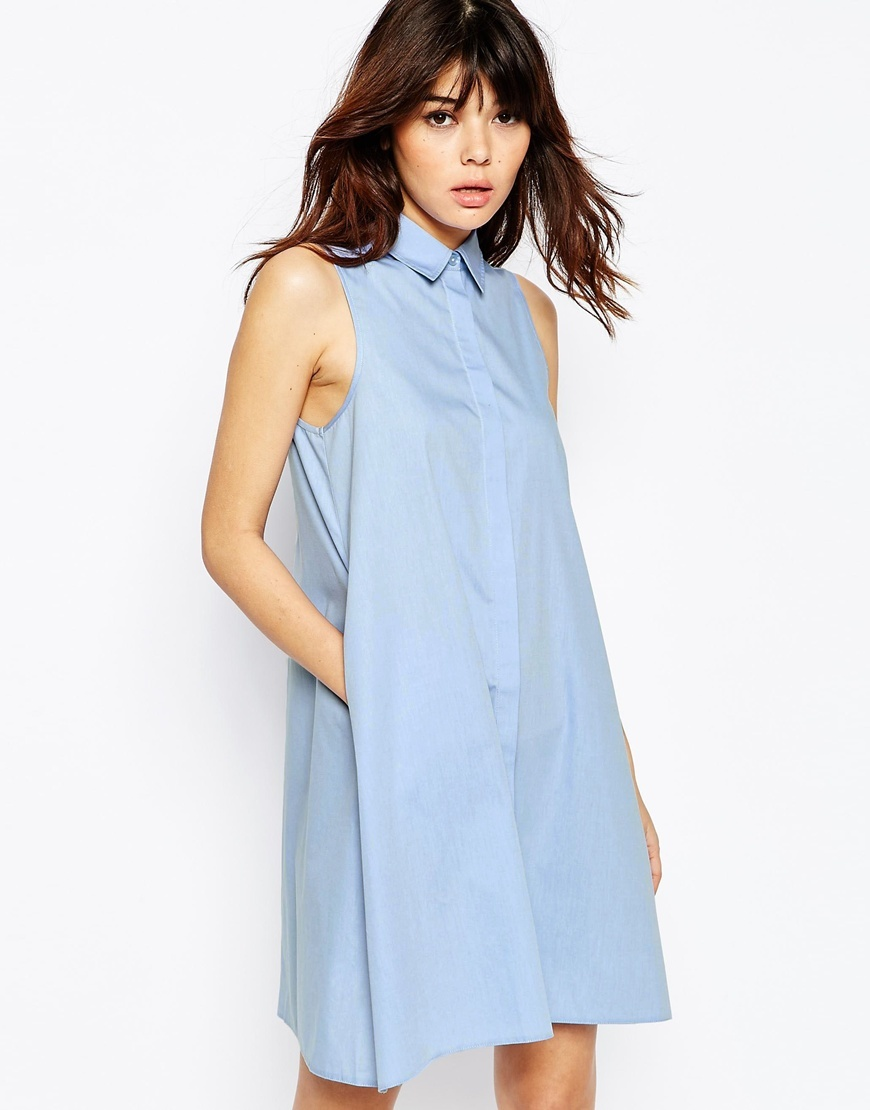 Sleeveless Shirt Dress In Cotton Blue - style: shirt; neckline: shirt collar/peter pan/zip with opening; fit: loose; pattern: plain; sleeve style: sleeveless; predominant colour: pale blue; occasions: casual; length: just above the knee; fibres: cotton - mix; sleeve length: sleeveless; texture group: cotton feel fabrics; pattern type: fabric; season: s/s 2016; wardrobe: highlight