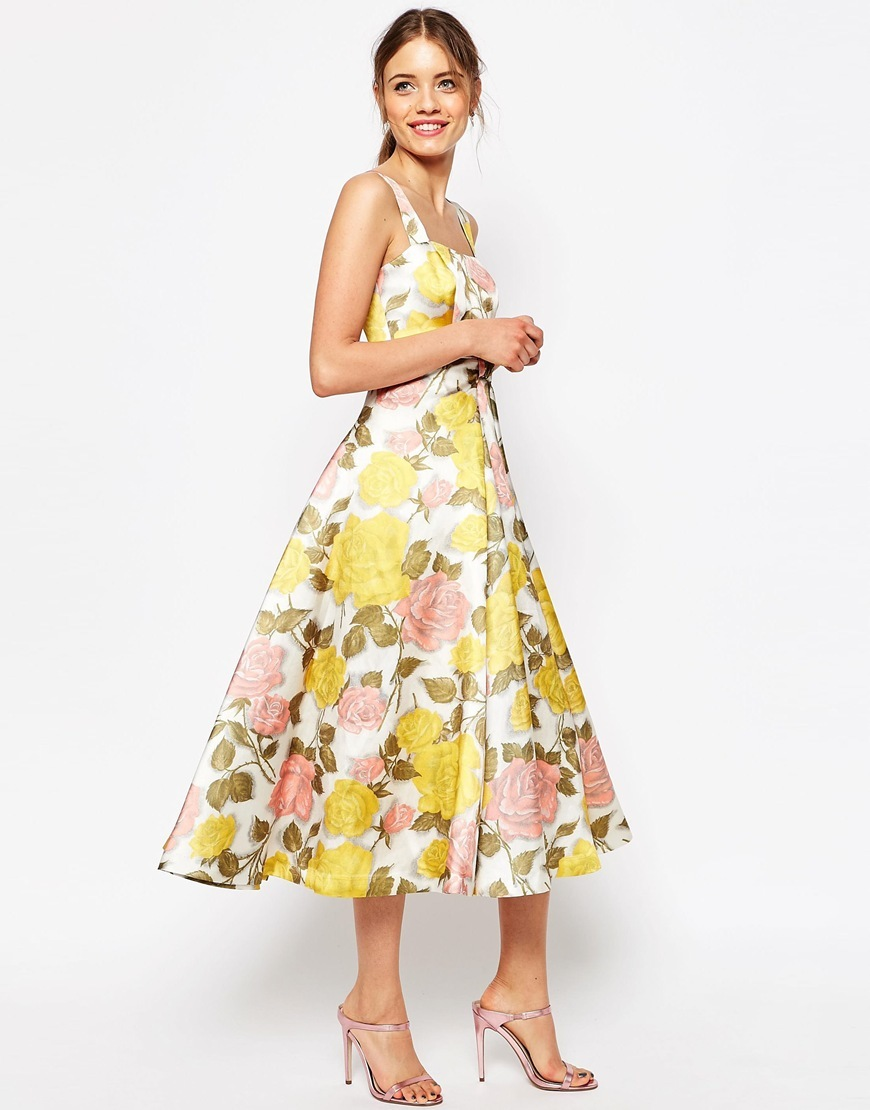 Bow Front Midi Prom Dress In Yellow And Pink Florals Multi - length: calf length; sleeve style: sleeveless; style: prom dress; predominant colour: white; secondary colour: yellow; occasions: evening, occasion; fit: fitted at waist & bust; neckline: scoop; fibres: polyester/polyamide - 100%; sleeve length: sleeveless; pattern type: fabric; pattern: florals; texture group: other - light to midweight; multicoloured: multicoloured; season: s/s 2016; wardrobe: event