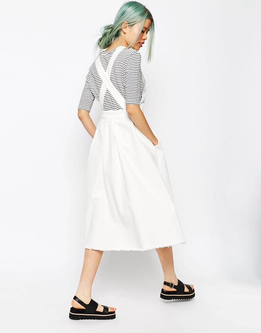Denim Cross Back Midi Dress In Off White With Raw Hem White/Off White - length: calf length; fit: tailored/fitted; pattern: plain; sleeve style: sleeveless; style: dungaree dress/pinafore; predominant colour: white; occasions: casual; fibres: cotton - 100%; back detail: crossover; sleeve length: sleeveless; texture group: denim; neckline: low square neck; pattern type: fabric; season: s/s 2016; wardrobe: highlight