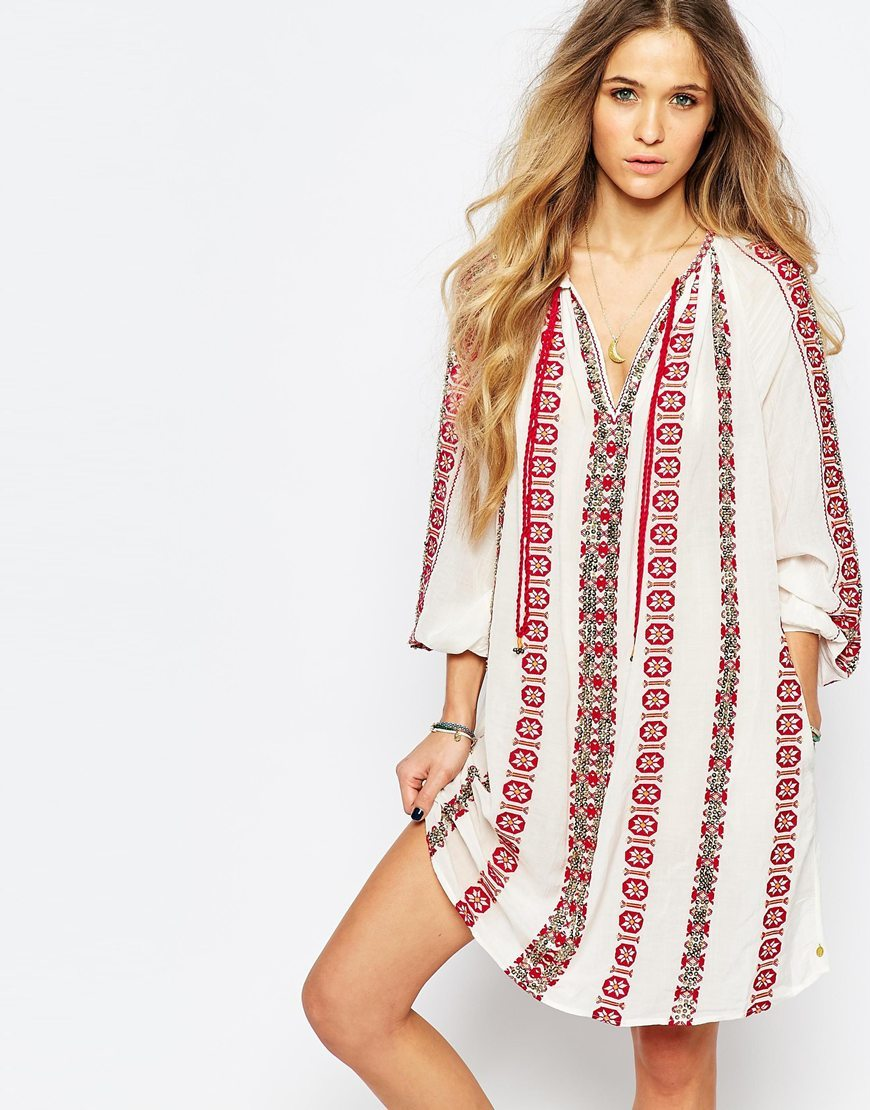 Beautiful Embroidered Dress Cream - neckline: low v-neck; fit: loose; style: kaftan; predominant colour: white; length: just above the knee; fibres: cotton - 100%; sleeve length: long sleeve; sleeve style: standard; occasions: holiday; pattern type: fabric; pattern size: standard; pattern: patterned/print; texture group: other - light to midweight; embellishment: embroidered; secondary colour: raspberry; season: s/s 2016; wardrobe: holiday; embellishment location: pattern