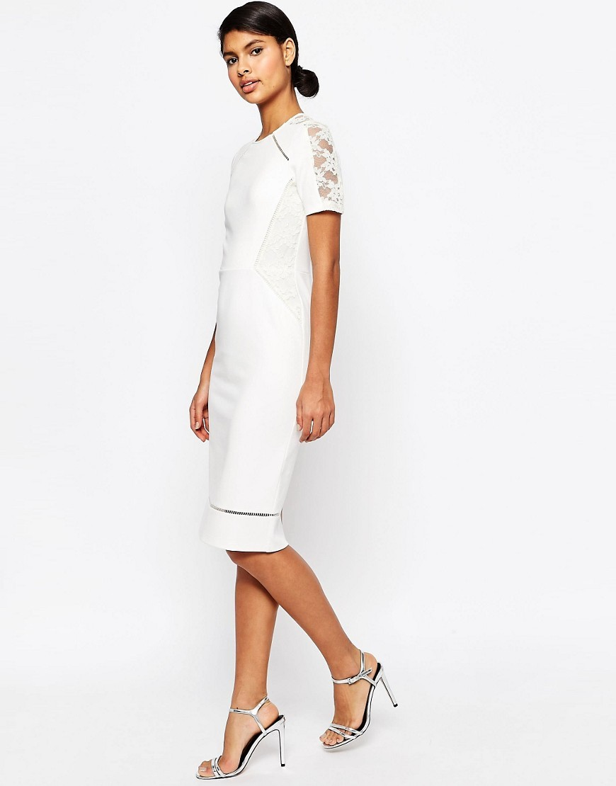 Pencil Dress With Lace And Ladder Insert Cream - style: shift; length: below the knee; fit: tailored/fitted; pattern: plain; hip detail: fitted at hip; predominant colour: ivory/cream; occasions: evening, occasion; fibres: polyester/polyamide - 100%; neckline: crew; sleeve length: short sleeve; sleeve style: standard; texture group: crepes; pattern type: fabric; embellishment: lace; shoulder detail: sheer at shoulder; season: s/s 2016