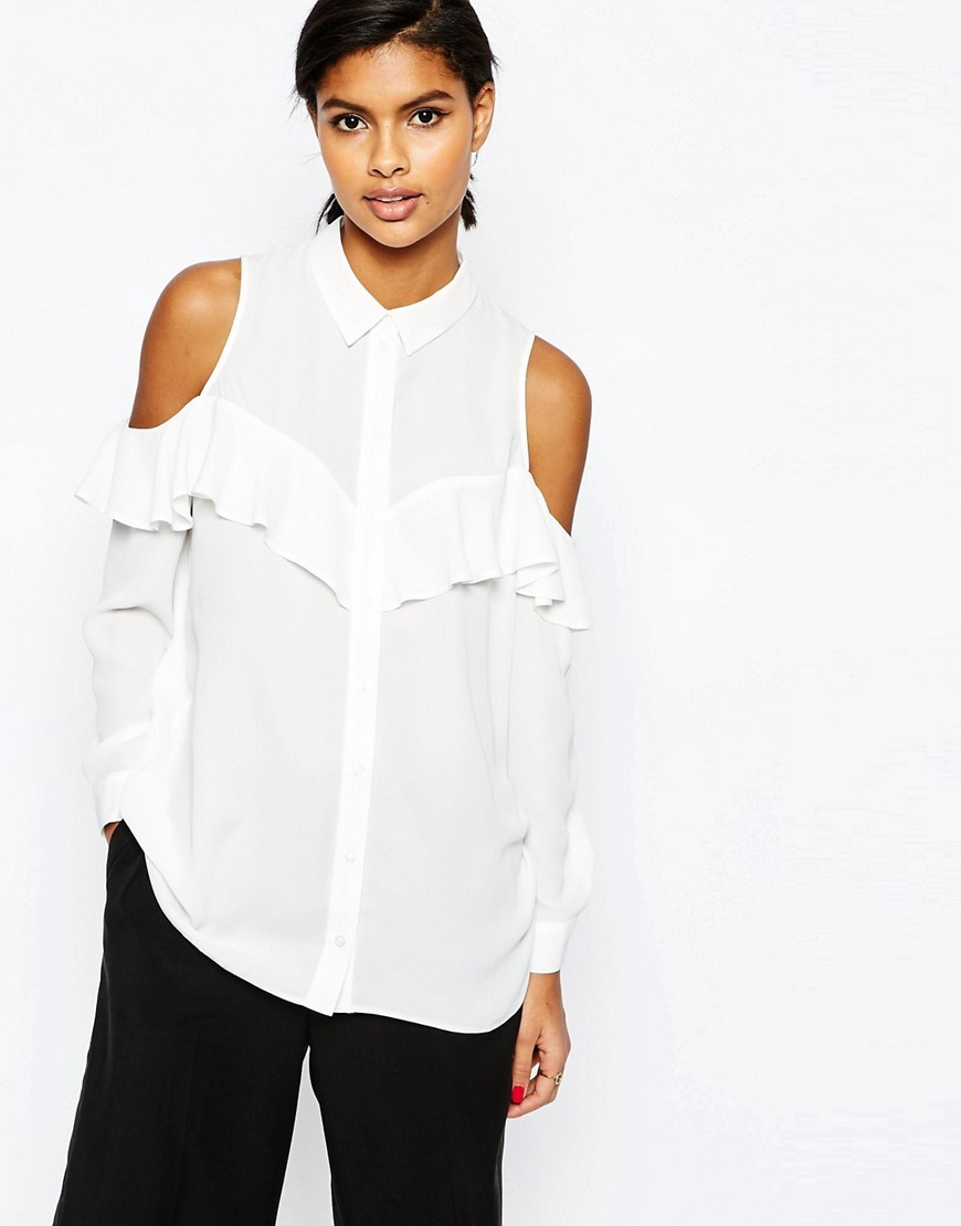 Cold Shoulder Blouse With Ruffle Ivory - neckline: shirt collar/peter pan/zip with opening; pattern: plain; length: below the bottom; style: blouse; predominant colour: white; occasions: casual, creative work; fibres: polyester/polyamide - 100%; fit: loose; shoulder detail: cut out shoulder; sleeve length: long sleeve; sleeve style: standard; bust detail: bulky details at bust; pattern type: fabric; texture group: other - light to midweight; season: s/s 2016; wardrobe: highlight